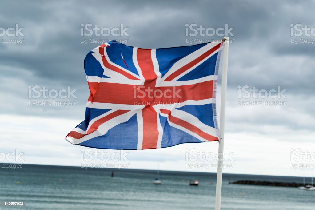 Flag of England against sea and storm clouds stock photo