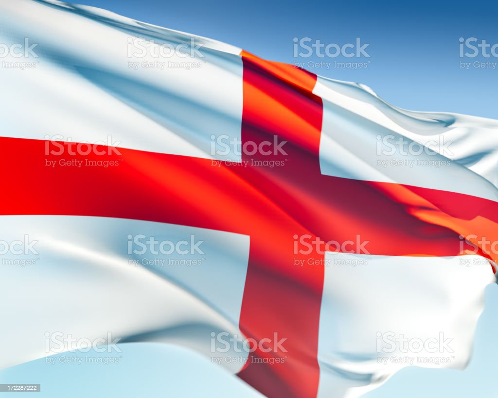 A flag of England blowing in the wind stock photo