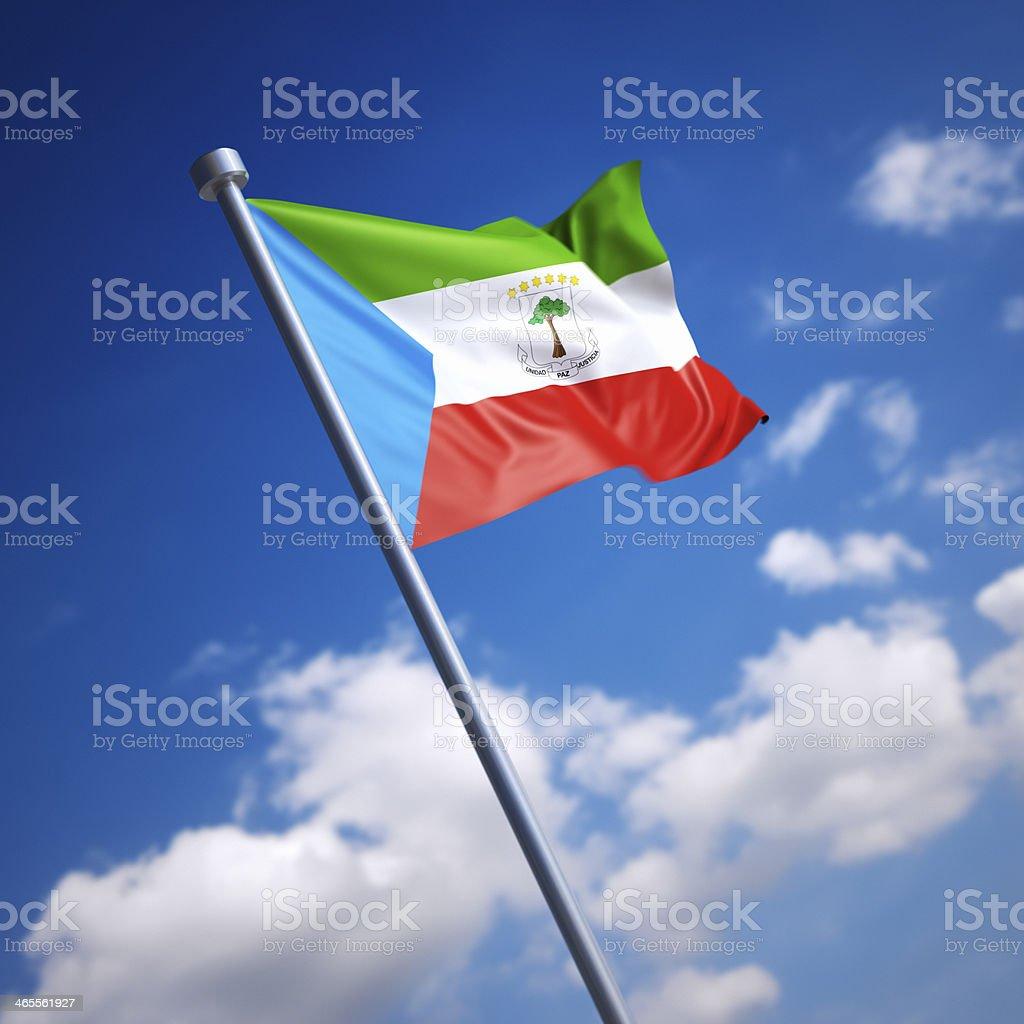 Flag of Equatorial Guinea against blue sky stock photo