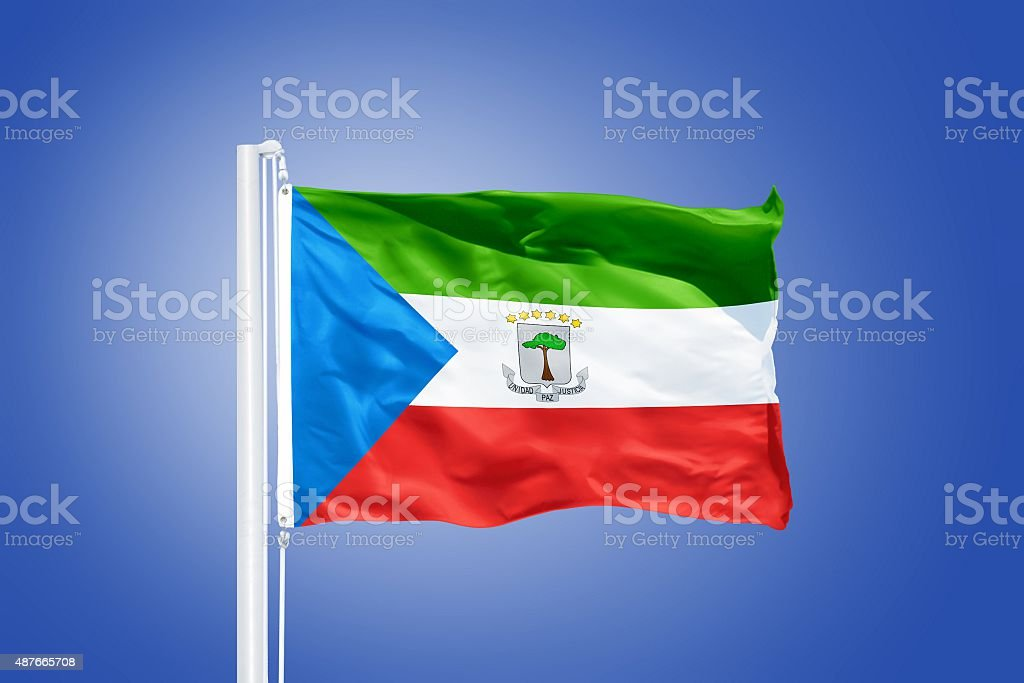 Flag of Equatorial Guinea flying against a blue sky stock photo