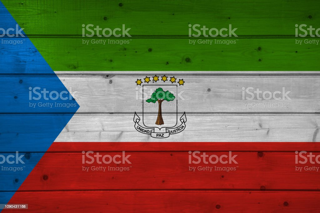 Flag Of Equatorial Guinea On Wooden Background Surface