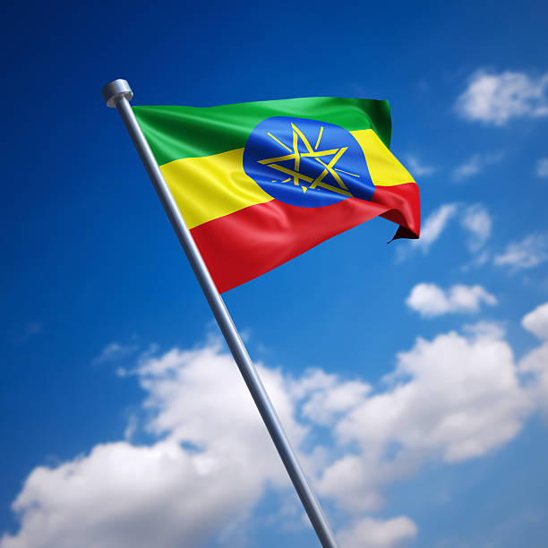 flag of ethiopia against blue sky - ethiopian flag stock photos and pictures