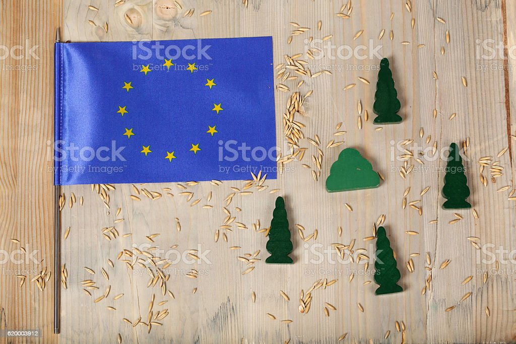 Flag of  EU and wooden made trees. stock photo