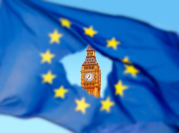 flag of eu with big ben in the hole - brexit stockfoto's en -beelden