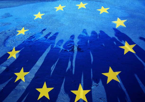 Flag of European Union with silhouette of people stock photo