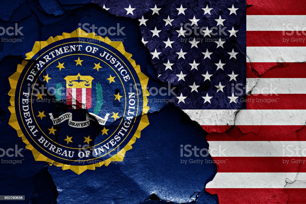 flag of FBI and USA painted on cracked wall stock photo