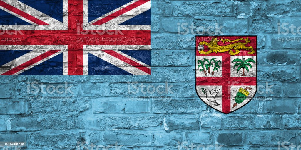 Bandera de Fiji sobre un antiguo fondo de pared ladrillo, superficie - foto de stock