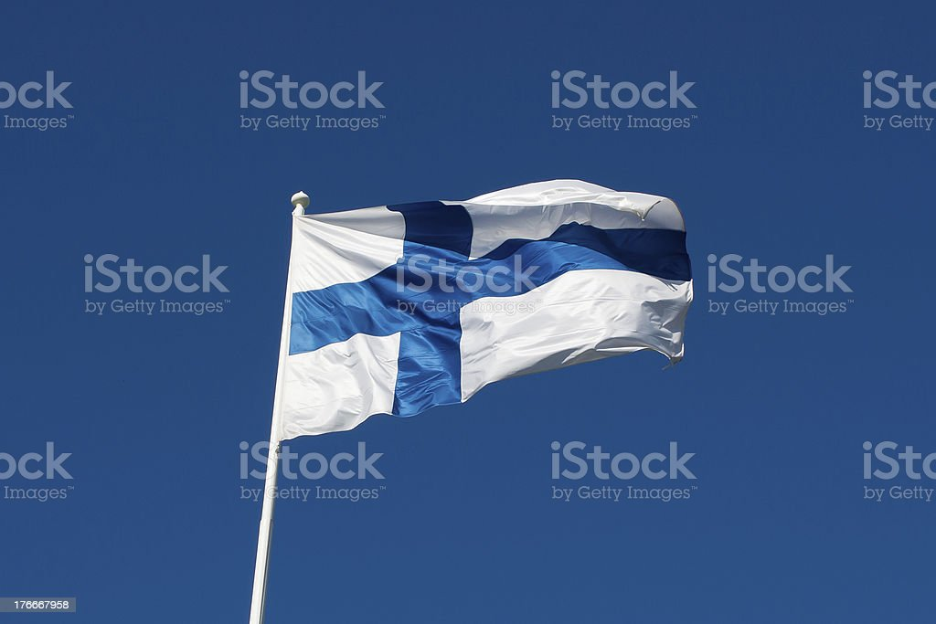 Flag of Finland before blue sky. royalty-free stock photo
