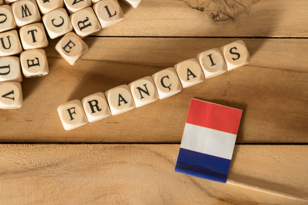 Flag of France and the word French Flagge von Frankreich und das Wort Französisch french culture stock pictures, royalty-free photos & images