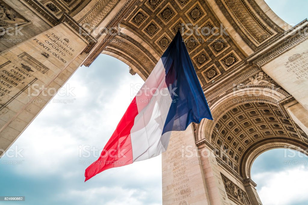 Flag of France at Arc de Triomphe stock photo