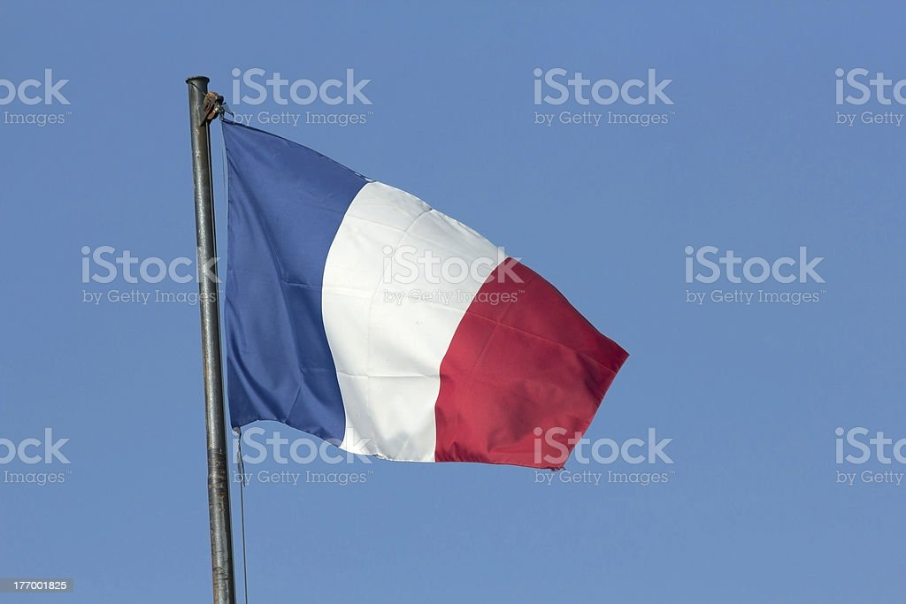 Flag of France flowing in the wind stock photo
