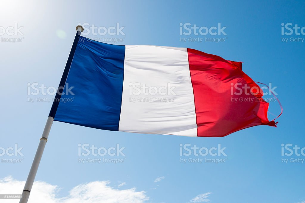 Flag of France flying in wind stock photo