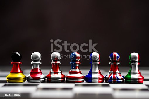 istock Flag of G7 countries print screen on pawn chess with black background. G7 are includes USA Germany Japan Canada France England and Italy. 1199234037