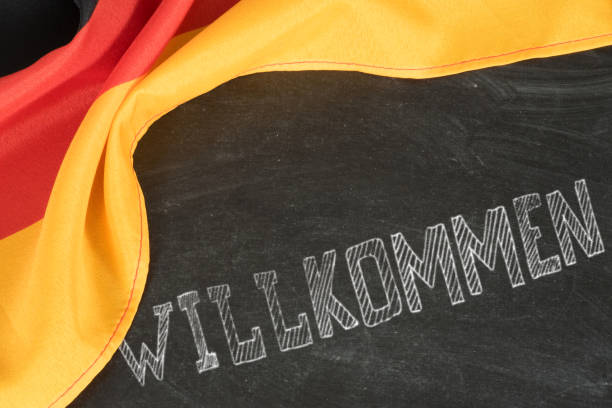 Flag of Germany and slogan Welcome stock photo