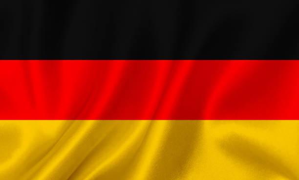flagge deutschlands winken hintergrund - stoffe berlin stock-fotos und bilder