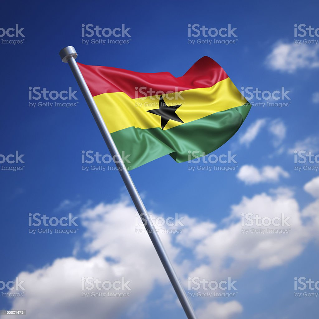 Flag of Ghana against blue sky stock photo
