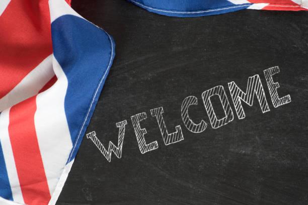 Flagge von Großbritannien und Slogan Willkommen – Foto