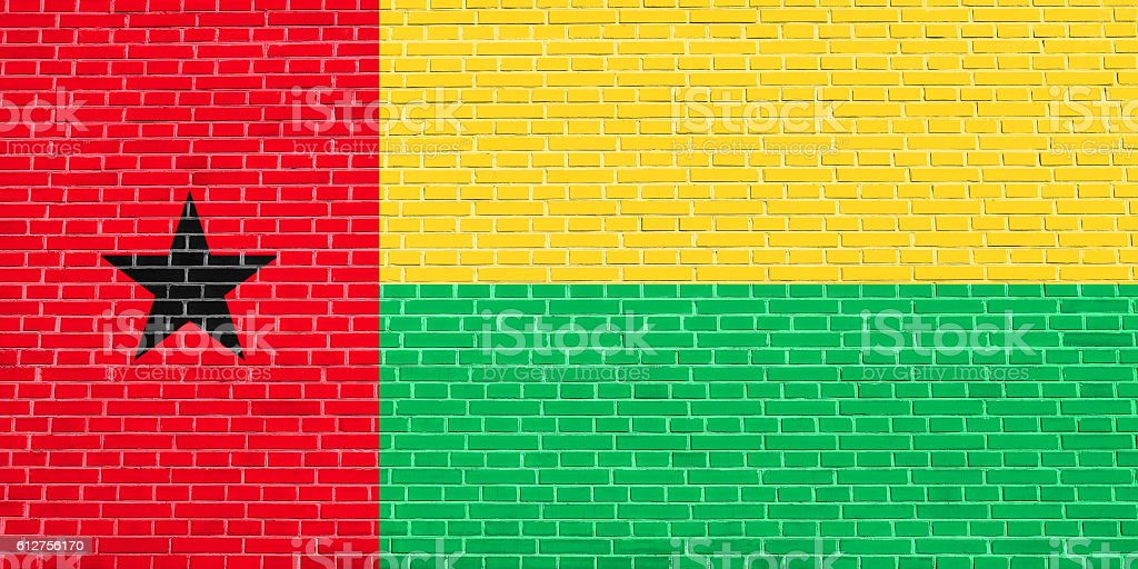 Flag of Guinea-Bissau, brick wall texture backdrop stock photo