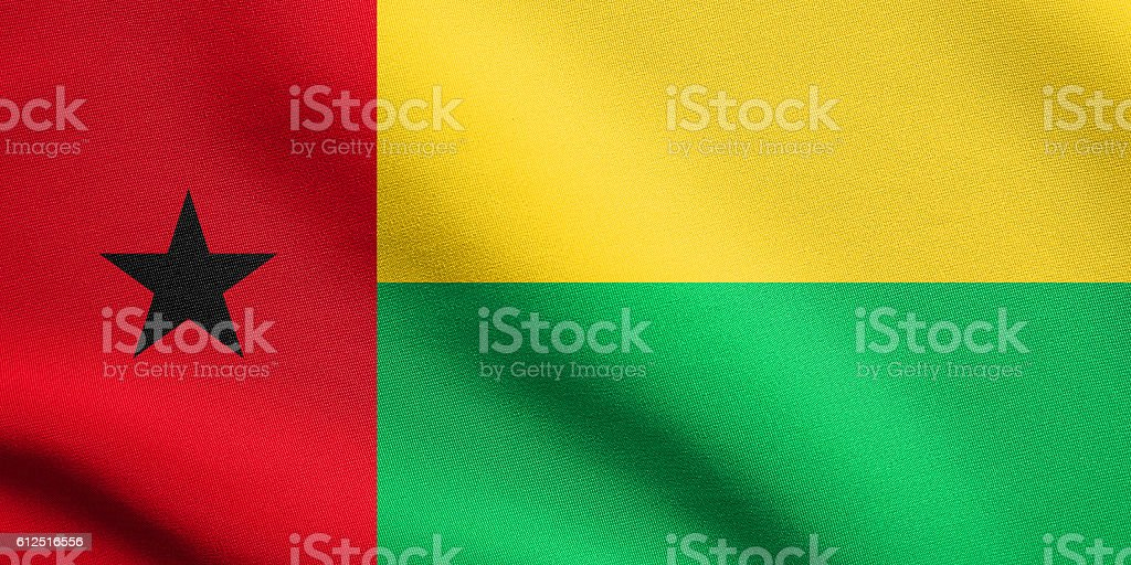Flag of Guinea-Bissau waving with fabric texture stock photo