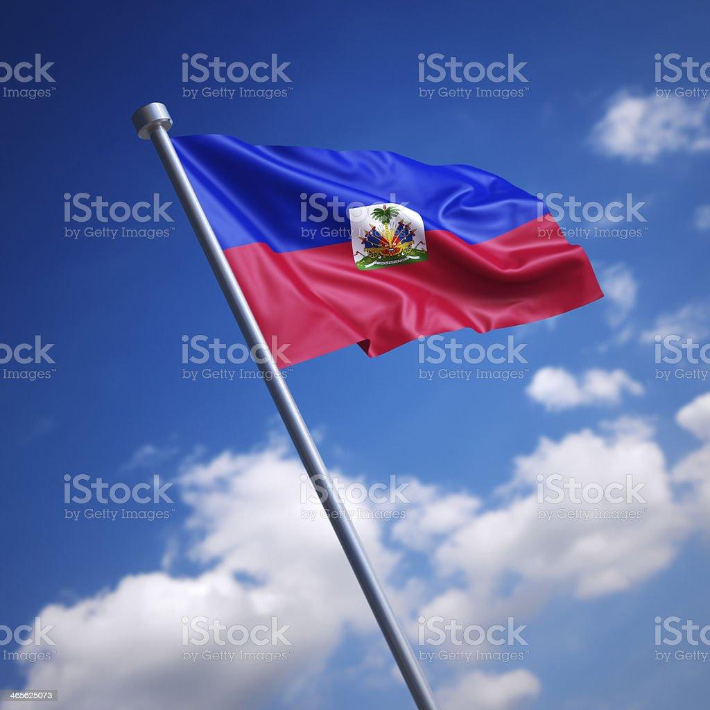 Flag of Haiti against blue sky stock photo
