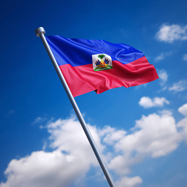 Flag of Haiti against blue sky Flag of the Republic of Haiti. Shallow depth of field and motion blur 3d render. Haiti Flag stock pictures, royalty-free photos & images