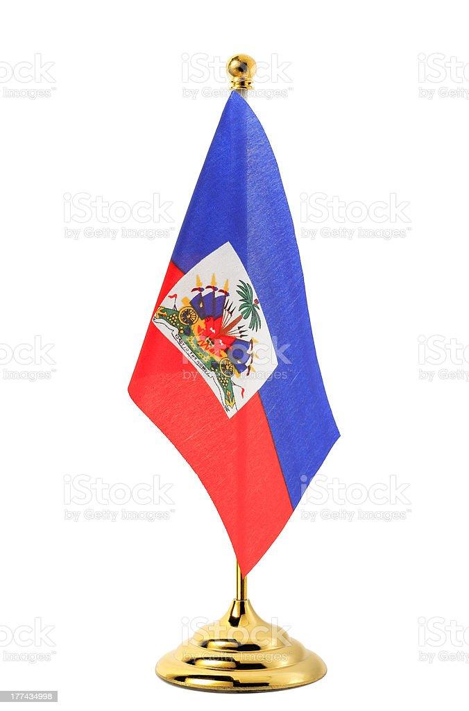 Flag of Haiti hanging on the gold flagpole stock photo