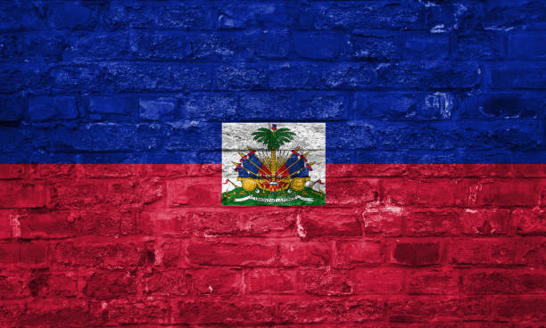 Flag of Haiti over an old brick wall background, surface Flag of Haiti over an old brick wall background, surface. National flag and symbol. Haiti Flag stock pictures, royalty-free photos & images