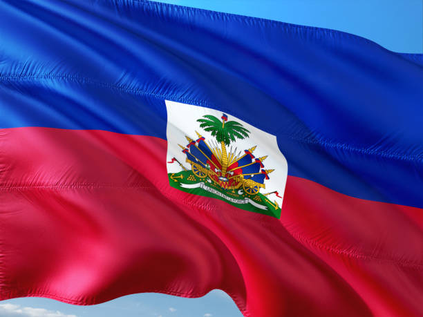 Flag of Haiti waving in the wind against deep blue sky. High quality fabric. Flag of Haiti waving in the wind against deep blue sky. High quality fabric. Haiti Flag stock pictures, royalty-free photos & images