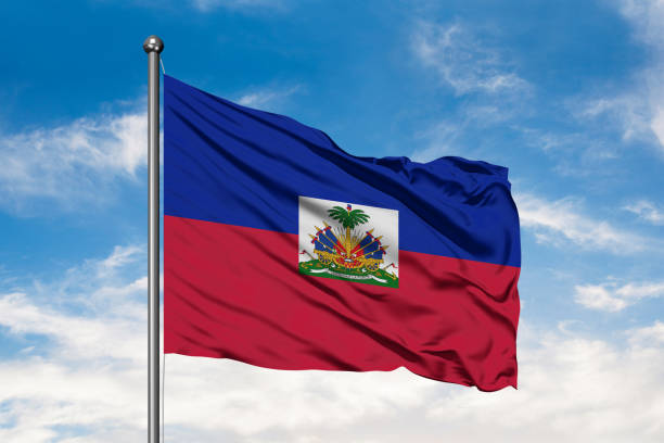 Flag of Haiti waving in the wind against white cloudy blue sky. Haitian flag. Flag of Haiti waving in the wind against white cloudy blue sky. Haitian flag. Haiti Flag stock pictures, royalty-free photos & images