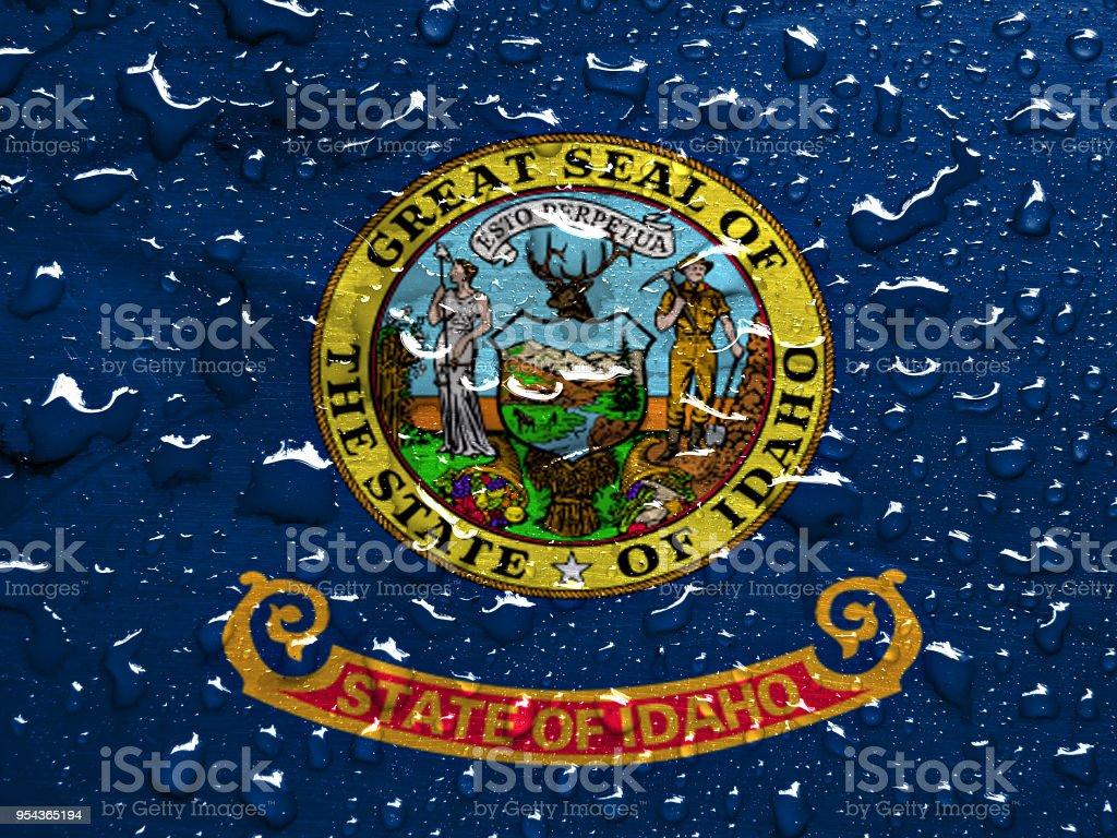 flag of Idaho with rain drops stock photo