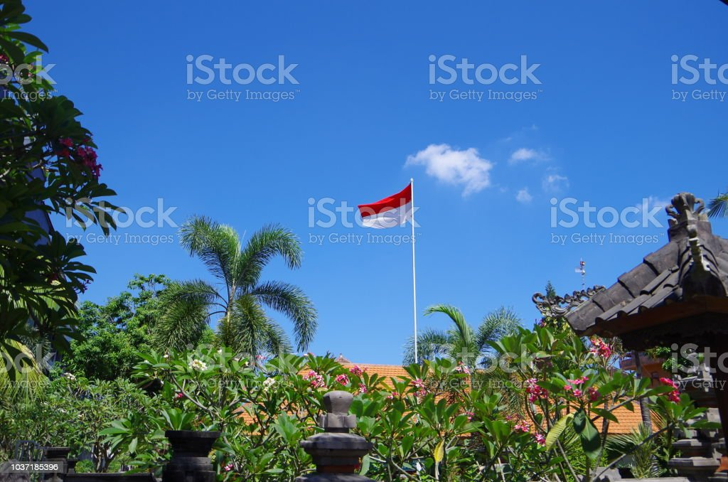 Flag of Indonesia under the blue sky stock photo