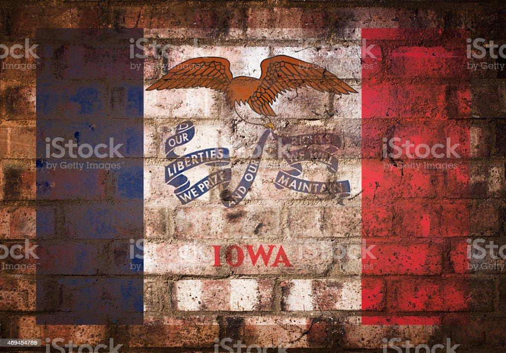 Flag of Iowa on Rustic Brick Wall stock photo