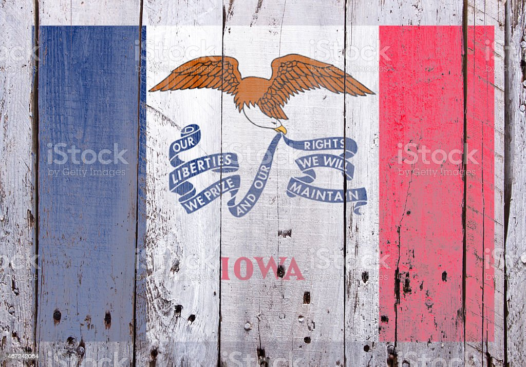 Flag of Iowa on Rustic Worn Wood stock photo