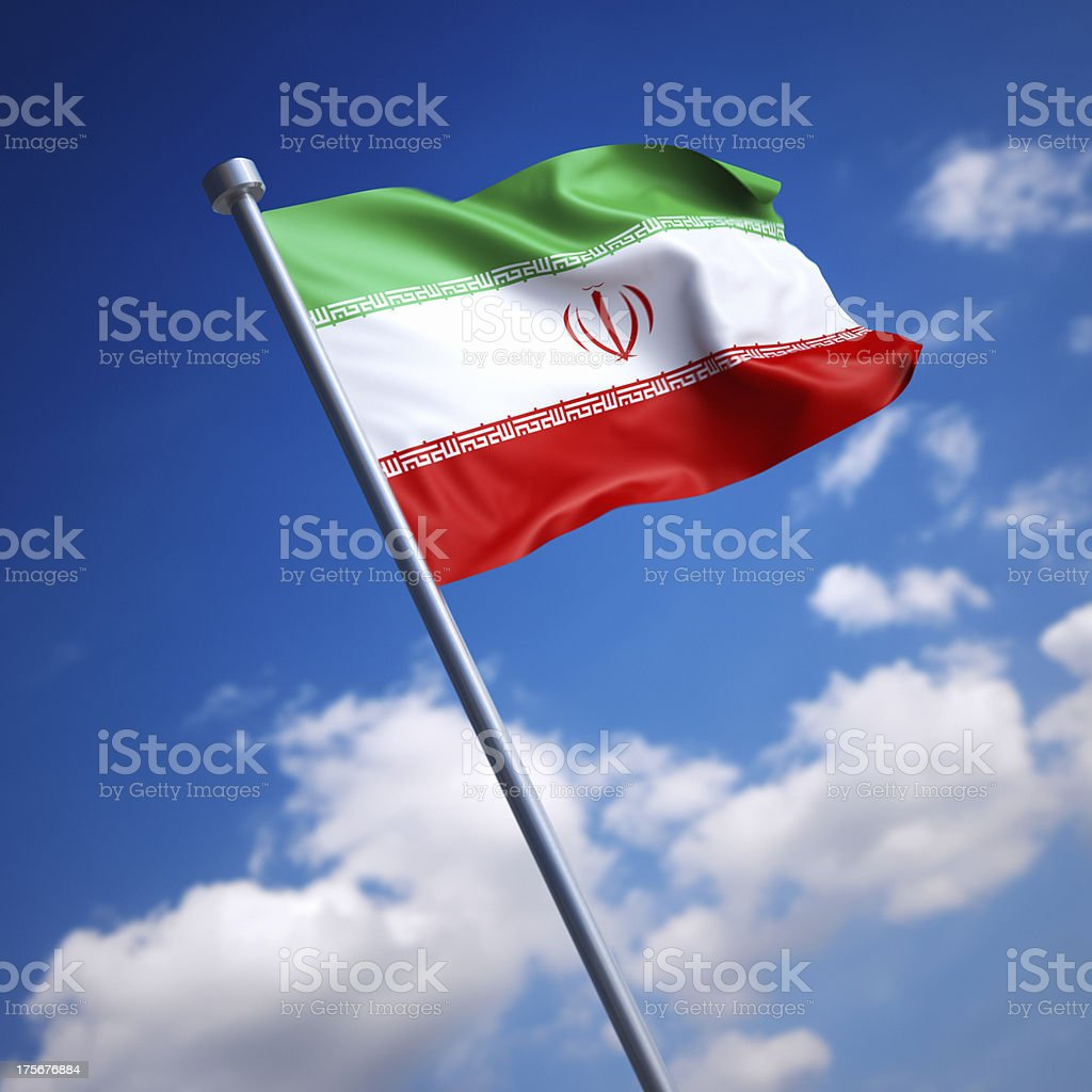 Flag of Iran against blue sky stock photo
