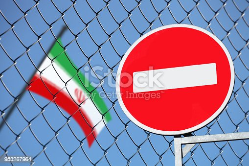 flag of Iran behind a fence