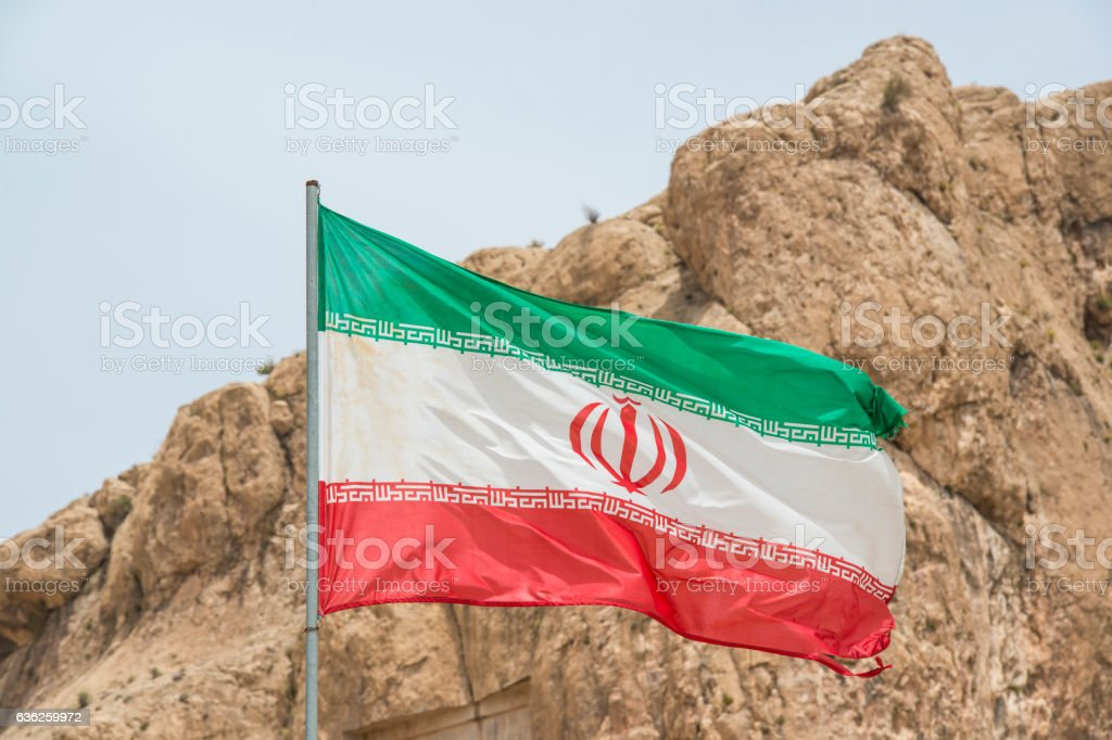 Flag of Iran in front of Persepolis stock photo