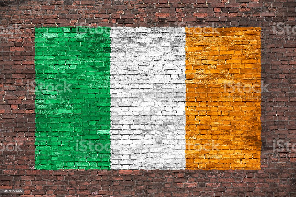 Flag of Ireland painted over brick wall stock photo