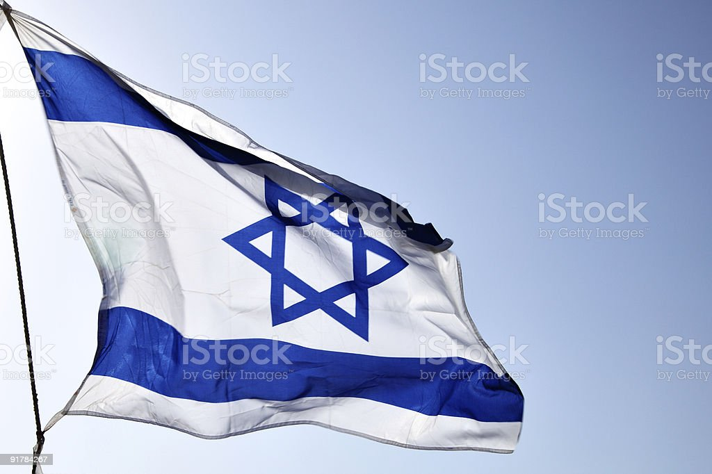 Flag of Israel rippling in the wind on a sunny day stock photo