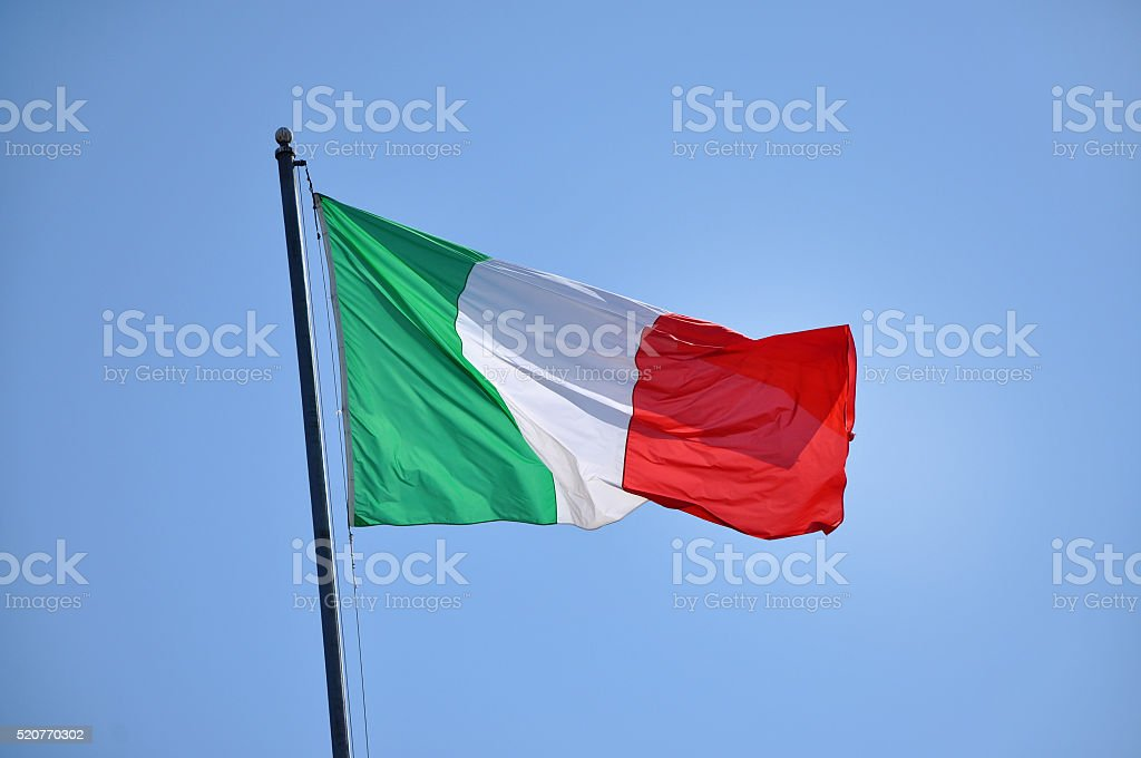 Flag of Italy blowing in the wind stock photo