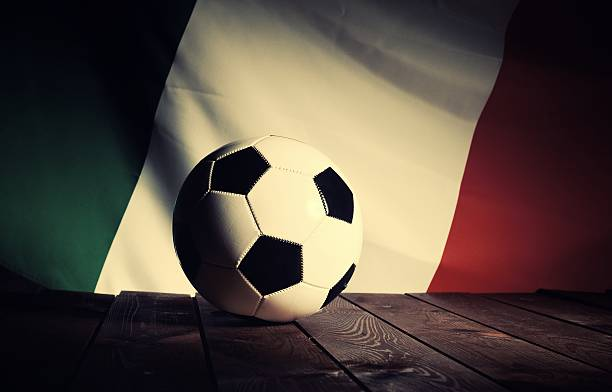 Flag of Italy with football on wooden boards as background. stock photo