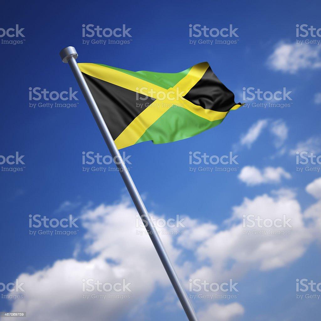 Bandeira da Jamaica contra o céu azul - foto de acervo