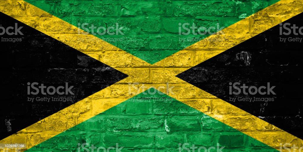 Bandeira da Jamaica sobre um antigo tijolo parede plano de fundo, superfície - foto de acervo