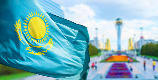 Flag of Kazakhstan in Astana Wind develops flag of the Republic of Kazakhstan in bacground Astana kazakhstan stock pictures, royalty-free photos & images