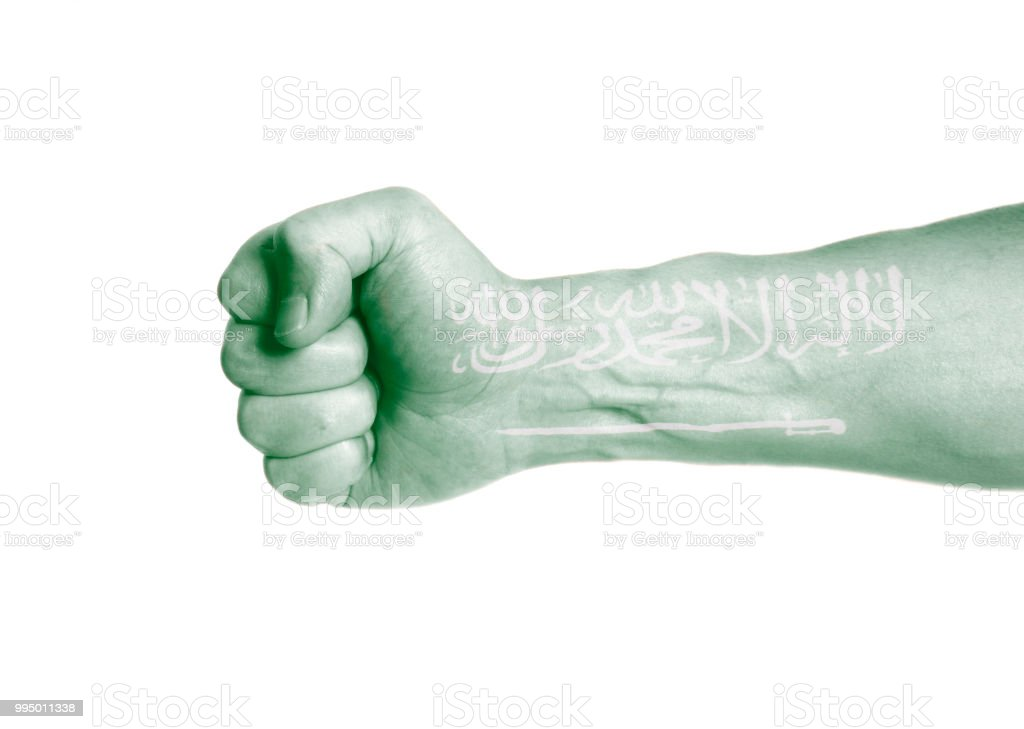 Flag Of Kingdom Of Saudi Arabia Painted On Male Hand With Clenched A