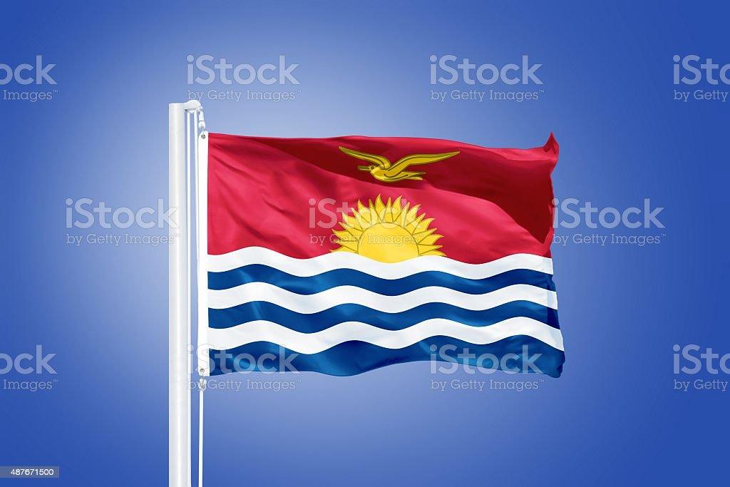 Flag of Kiribati flying against a blue sky stock photo
