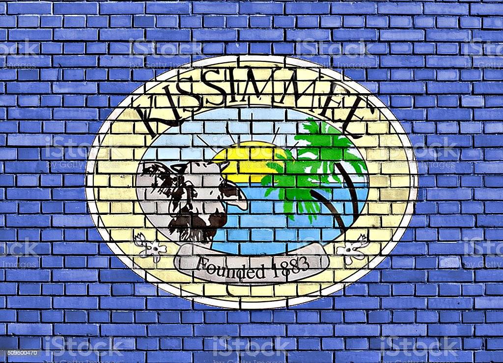 flag of Kissimmee painted on brick wall stock photo