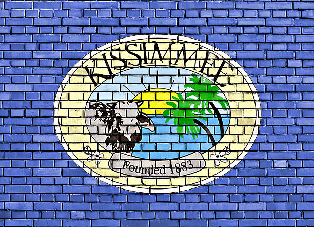 flag of kissimmee painted on brick wall - kissimmee stock photos and pictures