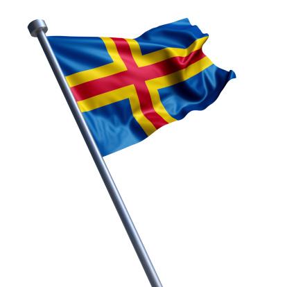 Flag of Åland Islands on modern metal flagpole.