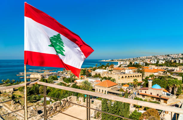 Flag of Lebanon at Byblos Castle Flag of Lebanon at the Crusader Castle in Byblos beirut stock pictures, royalty-free photos & images