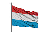 Flag of Luxembourg waving in the wind, isolated white background.